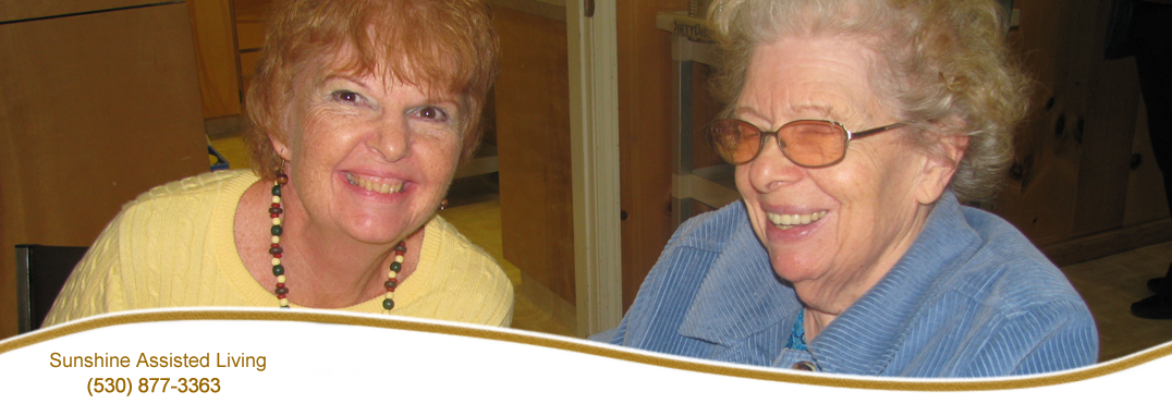 These two women pose for a photo at Sunshine Assisted Living.